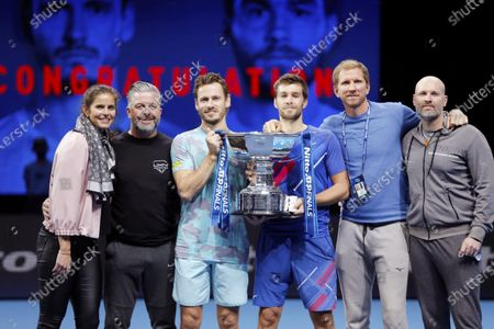Wesley Koolhof of Netherlands and Nikola Mektic of Croatia celebrate with the doubles trophy and their team including Julia Goerges of Germany