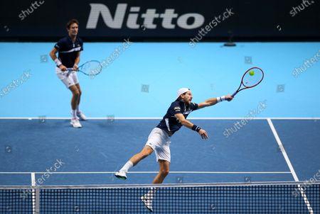 Jurgen Melzer of Austria and Edouard Roger-Vasselin of France in action