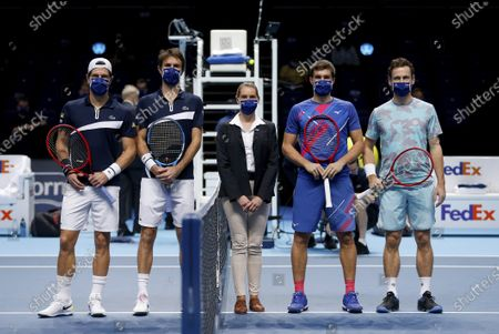 Stock Photo of Nikola Mektic of Croatia and Wesley Koolhof of Netherlands stand with Jurgen Melzer of Austria and Edouard Roger-Vasselin of France  and the umpire at the net