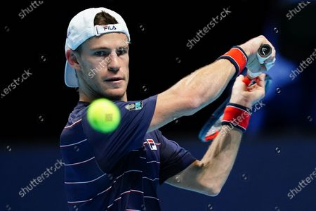Diego Schwartzman of Argentina keeps his eyes on the ball as he hits a backhand