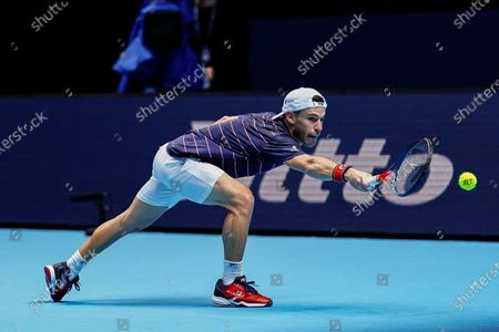 Stock Picture of Diego Schwartzman of Argentina stretches for the ball