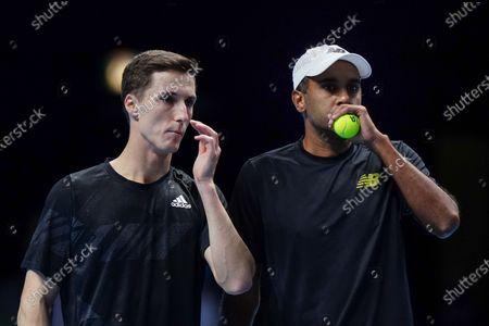 Joe Salisbury of Great Britain and Rajeev Ram of USA discuss tactics in the Men's Doubles