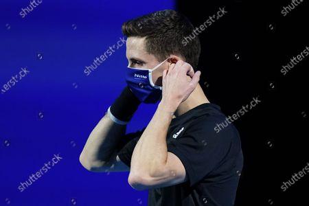 Joe Salisbury of Great Britain adjusts his face mask