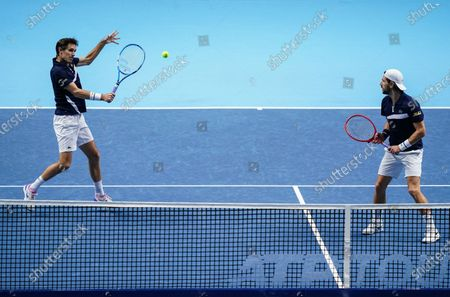 Jurgen Melzer of Austria and Edouard Roger-Vasselin of France in action at the net in the Men's Doubles Final