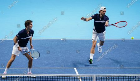 Jurgen Melzer of Austria and Edouard Roger-Vasselin of France in action in the Men's Doubles Final