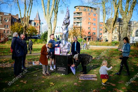 Visitors at the controversial Mary Wollstonecraft sculpture by Maggi Hambling on Newington Green