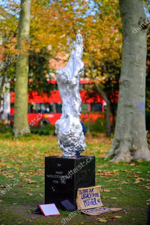 Stock Image of Visitors at the controversial Mary Wollstonecraft sculpture by Maggi Hambling on Newington Green