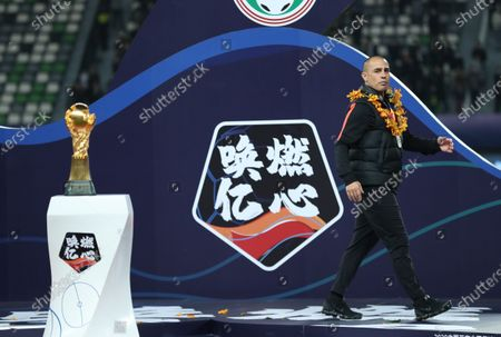 Fabio Cannavaro, head coach of Guangzhou Evergrande Taobao, walks past the Chinese Super League (CSL) trophy during the trophy ceremony after the 20th round match between Guangzhou Evergrande Taobao and Jiangsu Suning at 2020 season Chinese Football Association Super League (CSL) Suzhou Division in Suzhou, east China's Jiangsu Province, Nov. 12, 2020. Jiangsu Suning won its first CSL title after a 2-1 victory over defending champion Guangzhou Evergrande.