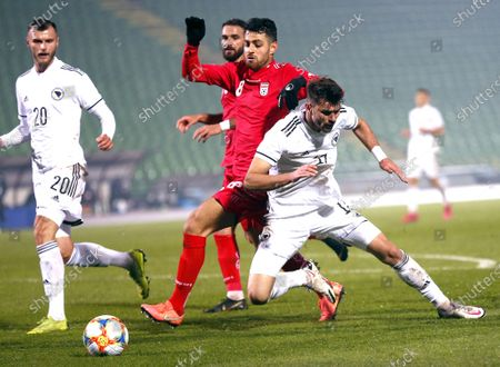 Amar Rahmanovic (R) of Bosnia and Morteza Pouraliganji (L) of Iran in action during a friendly soccer match between Bosnia and Herzegovina vs Iran in Sarajevo, Bosnia and Herzegovina, 12 November 2020.