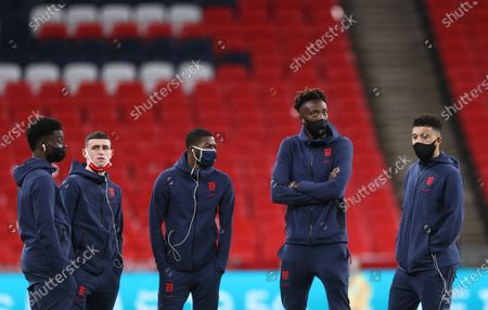 Stock Picture of England's Phil Foden, second left, and Tammy Abraham, second right, stand on the pitch with teammates before the international friendly soccer match between England and Ireland at Wembley stadium in London, England