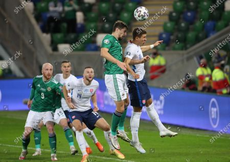 Northern Ireland's Craig Cathcart with Slovakia's Samuel Mraz during Thursday nights UEFA Euro 2020 Play-Off Final at the National Football Stadium at Windsor Park