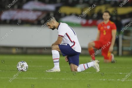 United States' Sebastian Lletget kneels before the international friendly soccer match between Wales and USA at Liberty stadium in Swansea, Wales