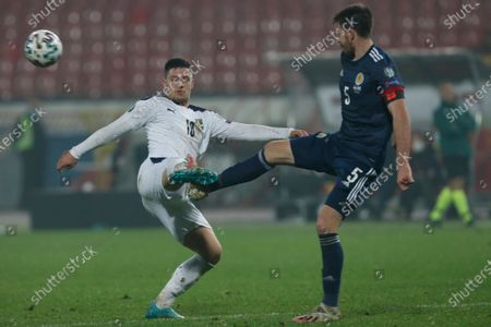 Serbia's Dusan Tadic, left, fights for the ball with Scotland's Declan Gallagher during the Euro 2020 playoff final soccer match between Serbia and Scotland, at the Rajko Mitic stadium in Belgrade, Serbia