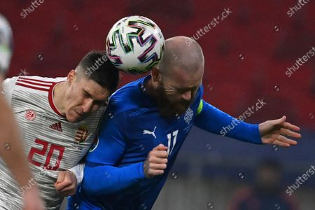 Aron Gunnarsson (R) of Iceland Roland Sallai of Hungary fight for the ball during the soccer UEFA EURO 2020 qualification play-off match Hungary vs. Iceland in Puskas Arena in Budapest, Hungary, 12 November 2020.