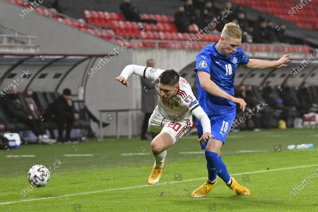 Hordur Magnusson (R) and Roland Sallai of Hungary fight for the ball during the soccer UEFA EURO 2020 qualification play-off match Hungary vs. Iceland in Puskas Arena in Budapest, Hungary, 12 November 2020.