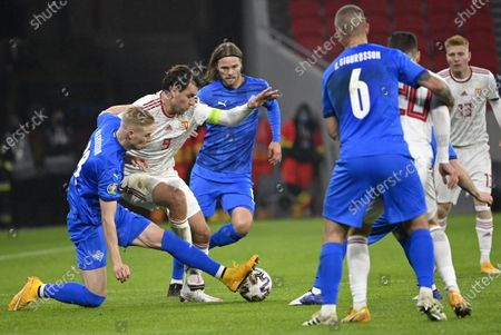 Hordur Magnusson (L) and Birkir Bjarnason (3RD L) of Iceland challenge Adam Szalai of Hungary for the ball during the soccer UEFA EURO 2020 qualification play-off match Hungary vs. Iceland in Puskas Arena in Budapest, Hungary, 12 November 2020.