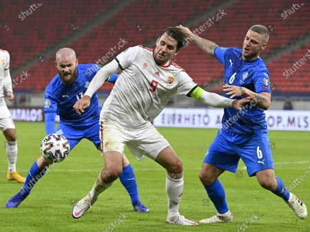 Ragnar Sigurdsson (R) and Aron Gunnarsson (b) of Iceland challenge Adam Szalai of Hungary for the ball during the soccer UEFA EURO 2020 qualification play-off match Hungary vs. Iceland in Puskas Arena in Budapest, Hungary, 12 November 2020.