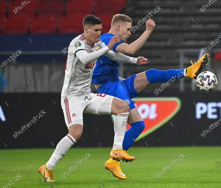 Hordur Magnusson (R) of Iceland and Roland Sallai of Hungary fight for the ball during the soccer UEFA EURO 2020 qualification play-off match Hungary vs. Iceland in Puskas Arena in Budapest, Hungary, 12 November 2020.