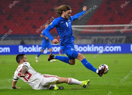 Birkir Bjarnason (R) of Iceland is challenged by Endre Botka of Hungary for the ball during the soccer UEFA EURO 2020 qualification play-off match Hungary vs. Iceland in Puskas Arena in Budapest, Hungary, 12 November 2020.