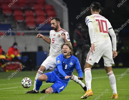 Birkir Bjarnason (C) is fouled by Attila Fiola (L) of Hungary during the soccer UEFA EURO 2020 qualification play-off match Hungary vs. Iceland in Puskas Arena in Budapest, Hungary, 12 November 2020.