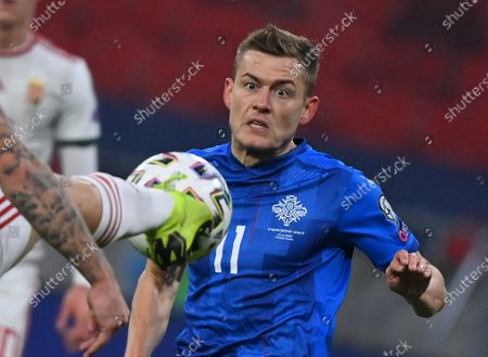 Stock Photo of Alfred Finnbogason of Iceland eyes the ball during the soccer UEFA EURO 2020 qualification play-off match Hungary vs. Iceland in Puskas Arena in Budapest, Hungary, 12 November 2020.