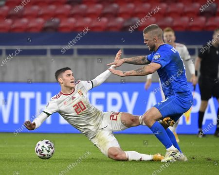 Ragnar Sigurdsson (R) of Iceland and Roland Sallai of Hungary fight for the ball during the soccer UEFA EURO 2020 qualification play-off match Hungary vs. Iceland in Puskas Arena in Budapest, Hungary, 12 November 2020.
