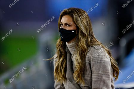 Stock Image of Broadcaster Erin Andrews watches as players warm up before an NFL football game between the Tennessee Titans and the Indianapolis Colts, in Nashville, Tenn