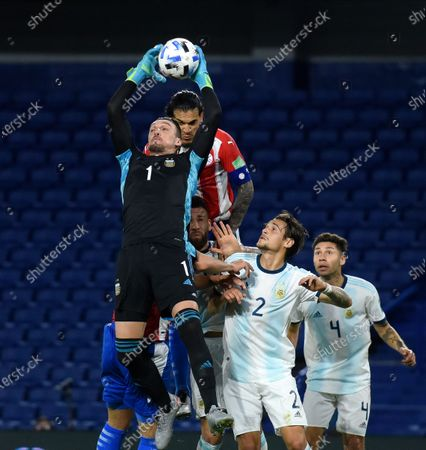 Argentina's goalkeeper Franco Armani, left, catches a ball during a qualifying soccer match against Paraguay for the FIFA World Cup Qatar 2022 in Buenos Aires, Argentina