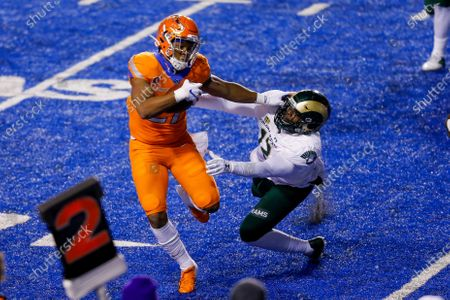 Boise State running back Andrew Van Buren (21) stiff-arms Colorado State linebacker Cam'ron Carter (12) on a run during the first half of an NCAA college football game, in Boise, Idaho