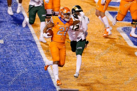 Boise State running back Andrew Van Buren (21) fends off Colorado State linebacker Cam'ron Carter (12) on a 1-yard touchdown during the first half of an NCAA college football game, in Boise, Idaho