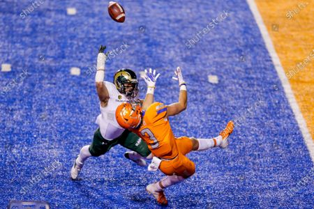 Boise State tight end Riley Smith (3) turns back for the ball as Colorado State defensive back Henry Blackburn (11) defends to break up the catch during the first half in an NCAA college football game, in Boise, Idaho. Boise State won 52-21