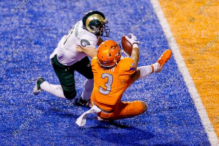 Boise State tight end Riley Smith (3) has the ball knocked from his hands by Colorado State defensive back Henry Blackburn (11) to break up the catch during the first half in an NCAA college football game, in Boise, Idaho. Boise State won 52-21