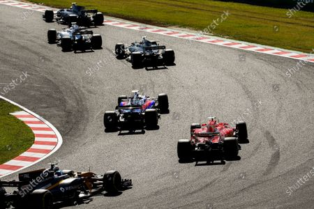Suzuka Circuit, Japan. Sunday 08 October 2017. Pierre Gasly, Toro Roso STR12 Renault, leads Sebastian Vettel, Ferrari SF70H, and Jolyon Palmer, Renault R.S.17.  World Copyright: Glenn Dunbar/LAT Images