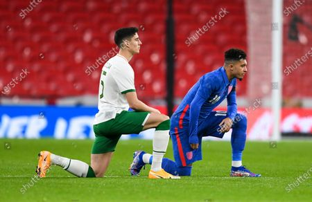Jordan Sancho of England and Callum O'Dowda of Ireland take a knee in support of Black Lives Matter
