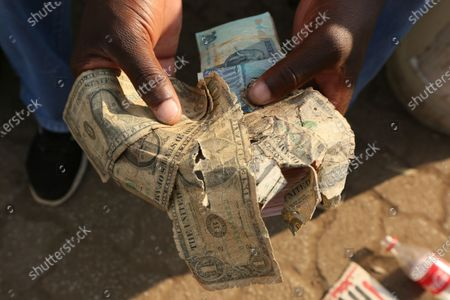 Editorial picture of Mending Dollars, Harare, Zimbabwe - 21 Oct 2020