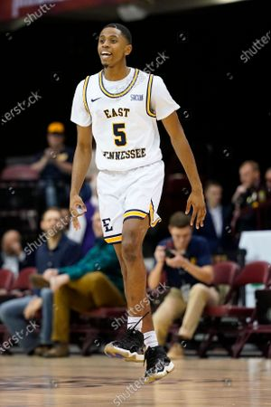 East Tennessee State guard Daivien Williamson (5) celebrates his team's early lead over Wofford during an NCAA college basketball game in the Southern Conference tournament in Asheville, N.C. Williamson played for Steve Forbes at ETSU, but has transferred to play for him at Wake Forest