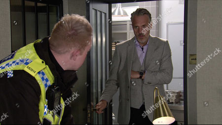 Coronation Street - Ep 10169 Monday 16th November 2020 - 1st Ep Ray Crosby, as played by Mark Frost, enters the office to find Craig Tinker, as played by Colson Smith, studying the plans for the redevelopment of the street.
