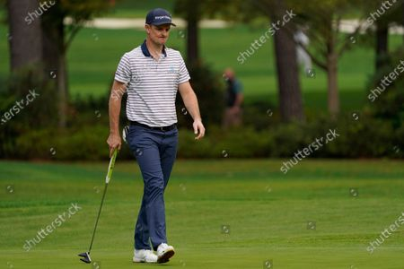 Justin Rose, of England, reacts after missing a birdie putt on the 15th hole during the first round of the Masters golf tournament, in Augusta, Ga