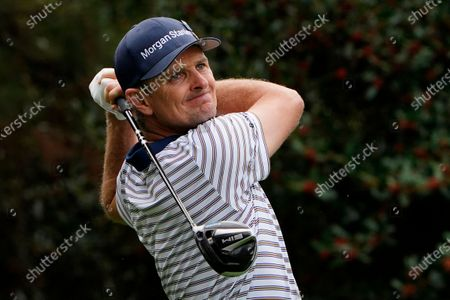 Justin Rose, of England, watches his tee shot on the 14th hole during the first round of the Masters golf tournament, in Augusta, Ga