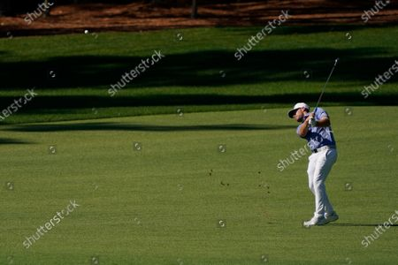 Tyrrell Hatton, of England, hits on the second fairway during the second round of the Masters golf tournament, in Augusta, Ga