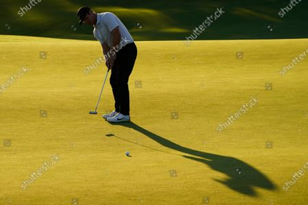 Paul Casey, of England, putts on the ninth green during the second round of the Masters golf tournament, in Augusta, Ga