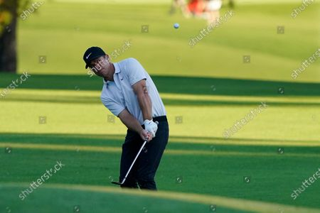 Paul Casey, of England, chips to the eighth green during the second round of the Masters golf tournament, in Augusta, Ga