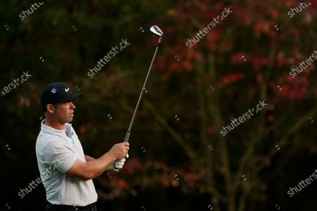 Paul Casey, of England, watches his shot on the 11th hole during the second round of the Masters golf tournament, in Augusta, Ga
