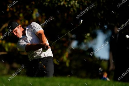 Paul Casey, of England, hits on the fourth fairway during the second round of the Masters golf tournament, in Augusta, Ga