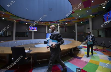 Stock Photo of European Council President Charles Michel arrives to participate in a videoconference call with Norway's Prime Minister Erna Solberg, on screen center, at the European Council building in Brussels