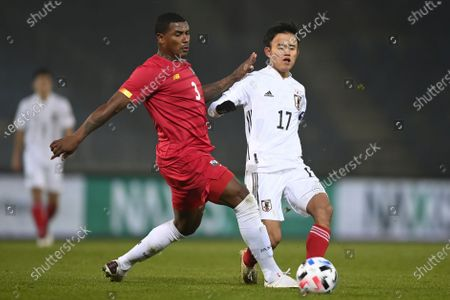 Harold Cummings of Panama (L) and Takefusa Kubo of Japan (R) in action during the international friendly match between Japan and Panama in Graz, Austria, 13 November 2020.