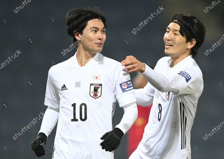 Takumi Minamino of Japan (L) celebrates with his team mate Genki Haraguchi (R) after scoring the 1-0 goal during the international friendly match between Japan and Panama in Graz, Austria, 13 November 2020.