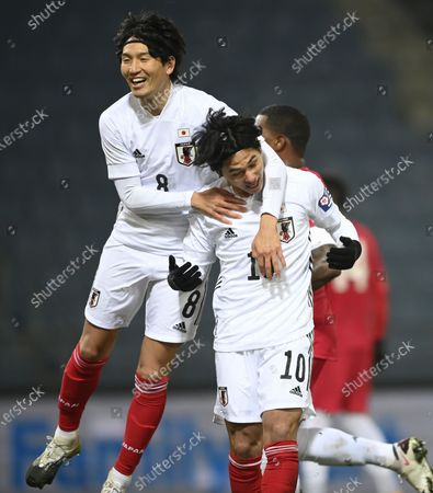 Takumi Minamino of Japan (R) celebrates with his team mate Genki Haraguchi (L) after scoring the 1-0 goal during the international friendly match between Japan and Panama in Graz, Austria, 13 November 2020.