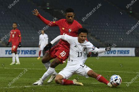 Edgar Barcenas of Panama (L) and Takefusa Kubo of Japan (R) in action during the international friendly match between Japan and Panama in Graz, Austria, 13 November 2020.