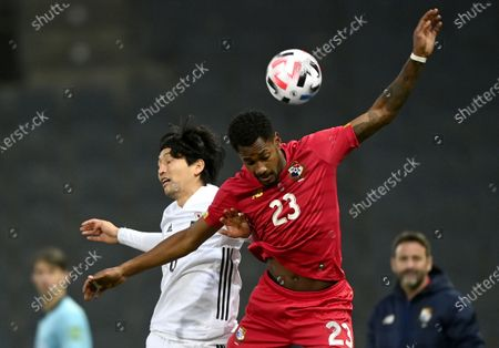 Genki Haraguchi of Japan (L) and Michael Murillo of Panama (R) in action during the international friendly match between Japan and Panama in Graz, Austria, 13 November 2020.